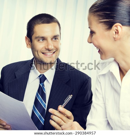 Happy businesspeople or client and businessman, giving pen for signing document, at office - stock photo