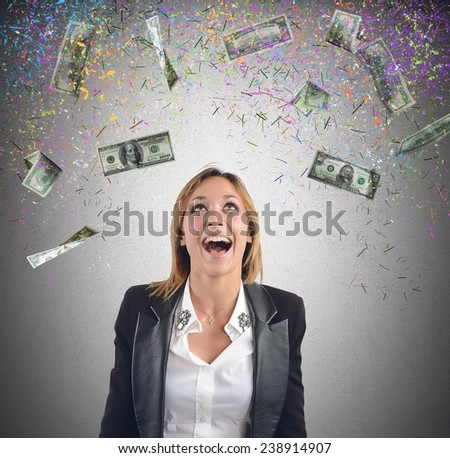 Happy businesswoman have earned lot of money - stock photo