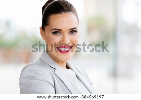 happy businesswoman looking at the camera - stock photo