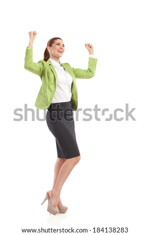 Happy businesswoman. Shouting businesswoman raising hands and pointing up. Full length studio shot isolated on white. - stock photo