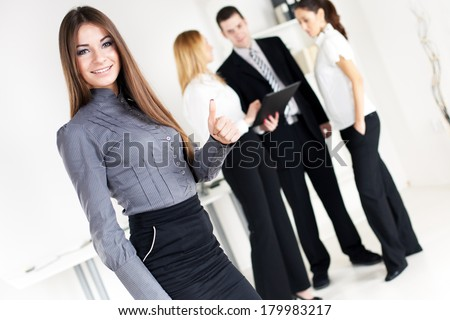 Happy Businesswoman showing thumbs up in the office, Looking at camera. Selective Focus. - stock photo