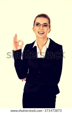 Happy businesswoman shows sign perfect - stock photo