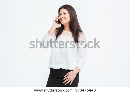 Happy businesswoman talking on the phone isolated on a white background - stock photo