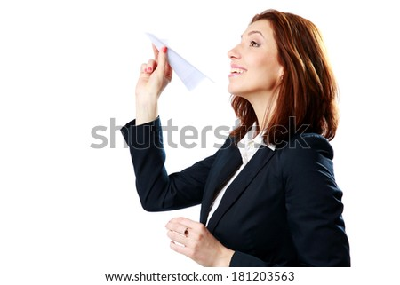 Happy businesswoman throwing paper plane isolated on a white background - stock photo