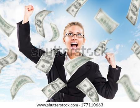 Happy Businesswoman under money rain. - stock photo