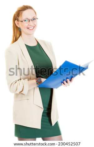 happy businesswoman wearing a green dress and jacket stands with folder - stock photo