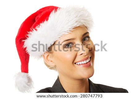 Happy businesswoman wearing christmas hat. - stock photo