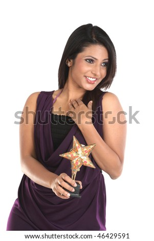 happy Businesswoman with star trophy - stock photo
