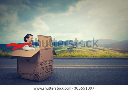 Happy car driver on a countryside road   - stock photo