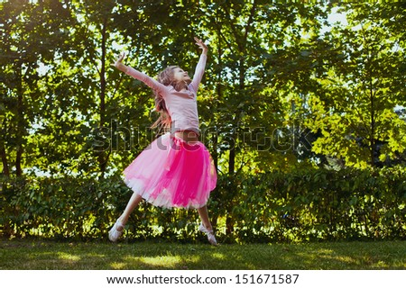 happy carefree childhood, seven years old caucasian child girl jumping outdoor - stock photo