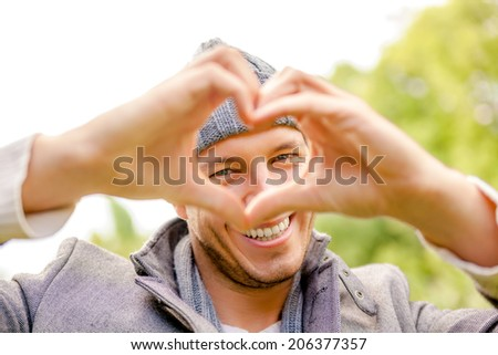 happy carefree male outdoors smiling green spring  - stock photo
