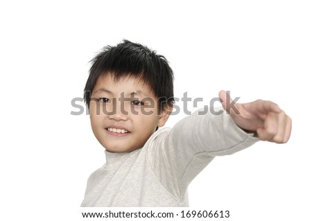 Happy casual little boy showing thumb up - stock photo