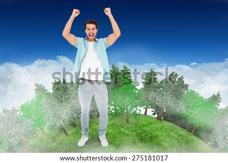 Happy casual man cheering at camera against bright blue sky over clouds - stock photo
