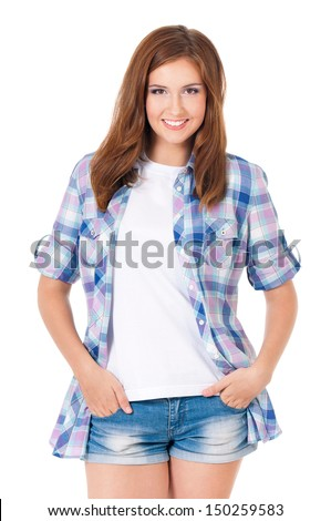 Happy casual young girl posing with hands in shorts pockets, isolated on white background - stock photo