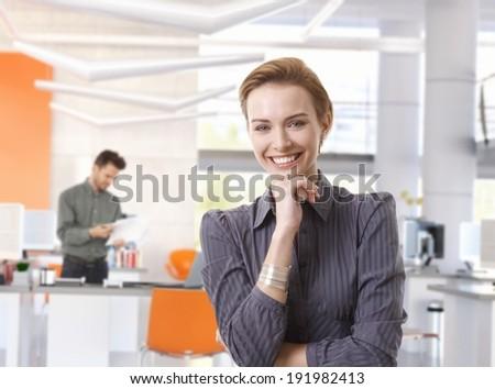Happy caucasian businesswoman in modern office. - stock photo