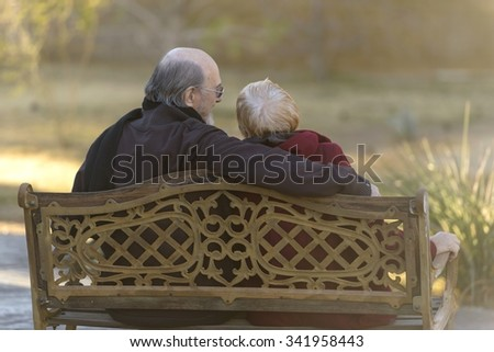Happy Caucasian elderly men with short red hair cuddling - stock photo