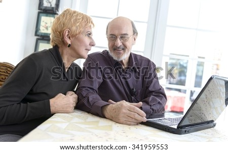 Happy Caucasian elderly men with short red hair talking - stock photo