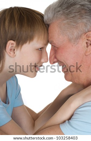 Happy Caucasian grandfather and grandson on a white background - stock photo