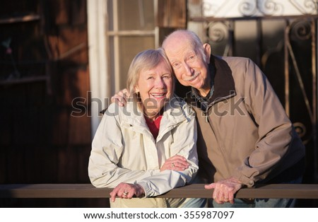 Happy Caucasian senior couple standing together outdoors - stock photo