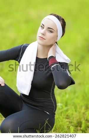 Happy caucasian Sportswoman Relaxing Outdoors. Vertical Image - stock photo