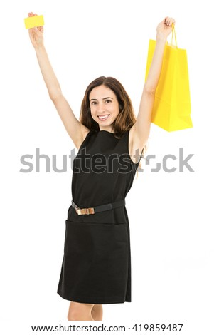 Happy caucasian woman showing credit card and shopping bag - stock photo