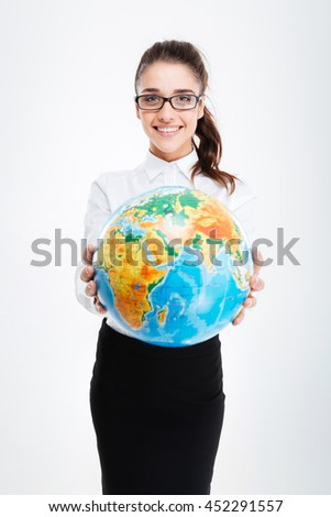 Happy charming young businesswoman giving you an earth globe over white background - stock photo