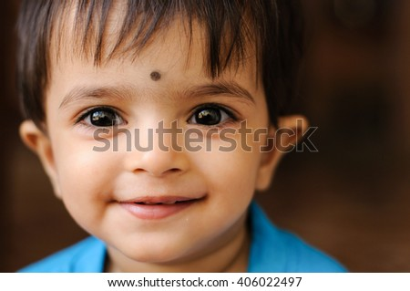 Happy cheerful beautiful / cute smiling Indian baby girl / toddler, North India, Indian daughter joyful young with naughty looks. people. infant face  - stock photo
