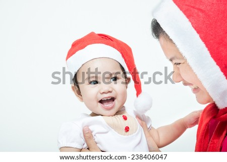 Happy cheerful family. Asian mother and baby kissing, laughing and hugging - stock photo