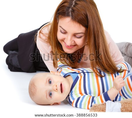 Happy cheerful family. Mother and baby boy kissing, laughing, hugging and playing. isolated on white background - stock photo