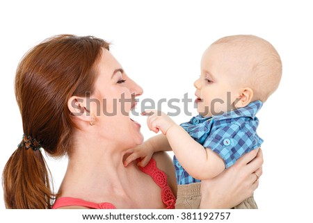 Happy cheerful family. Mother and baby kissing, laughing, hugging and playing. isolated on white background - stock photo