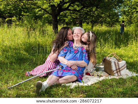 Happy cheerful family resting in the park - stock photo