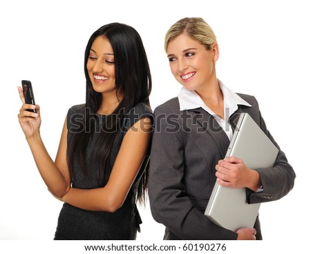 Happy cheerful Indian and Caucasian business women - stock photo