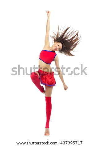 Happy cheerleader dancer from cheerleading team dancing and jumping in red blue uniform colors isolated on a white background - stock photo