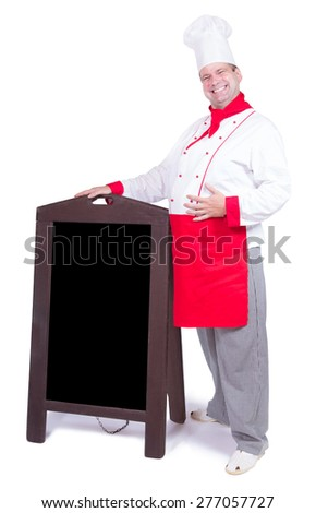 happy chef standing with an blank menu - stock photo