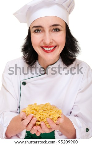 Happy chef woman holding macaroni handful in hands isolated on white - stock photo