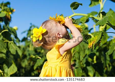 Happy child and sunflower, summer, nature - stock photo