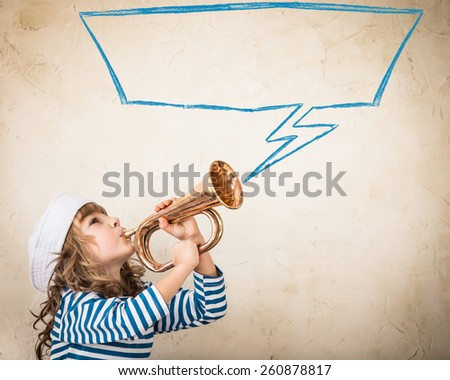 Happy child blowing vintage nautical horn. Kid having fun at home. Summer sea dream and imagination. Adventure and travel concept. Retro toned image - stock photo