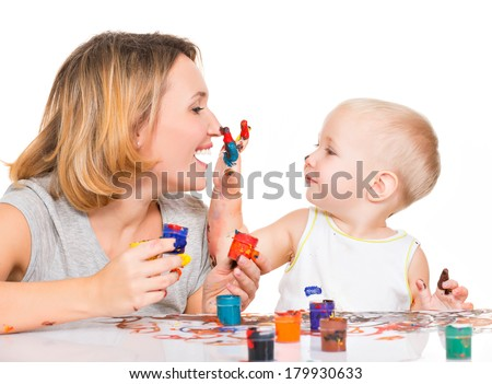 Happy child draws on the face of his mother - isolated on white. - stock photo