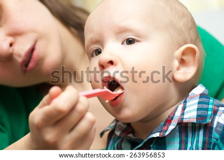 happy child eats baby food - stock photo