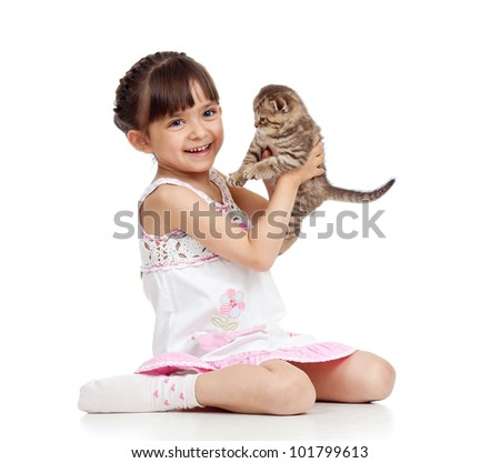 happy child girl holding  kitten - stock photo