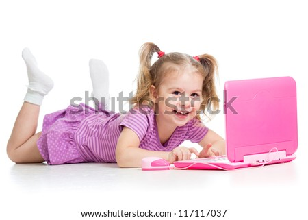 happy child girl playing with laptop toy - stock photo