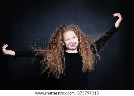 Happy Child Girl with Long Curly Hair - stock photo