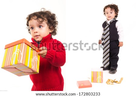 happy child holding a present set with a tie - stock photo