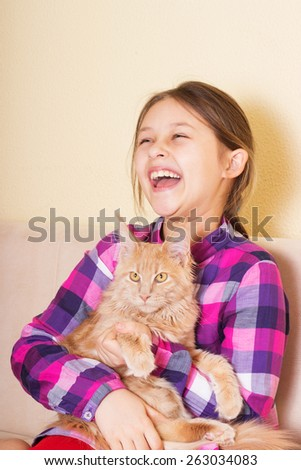 happy child hugging a kitten - stock photo