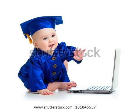 happy child in academician clothes  using laptop - stock photo
