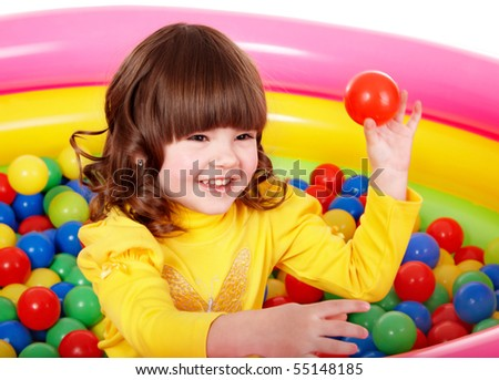Happy child in group colourful ball. - stock photo