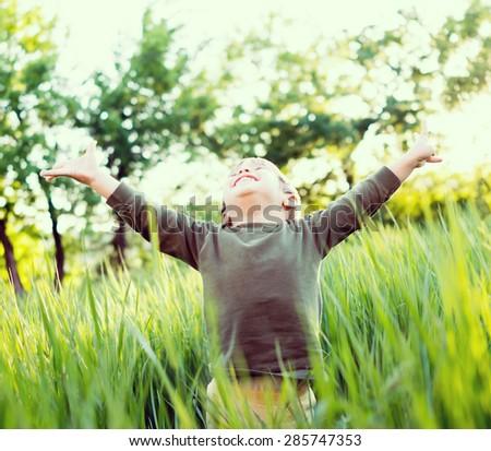 Happy child in park - stock photo