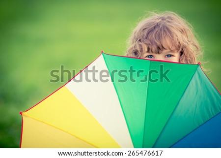 Happy child in spring field - stock photo