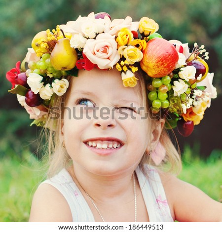 Happy Child in Summer.  Beautiful Girl with Flowers Wreath. Happy Children. Healthy Kids. Spring Time. - stock photo
