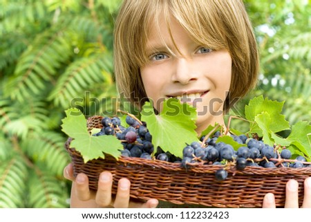 happy child in the vineyard - stock photo